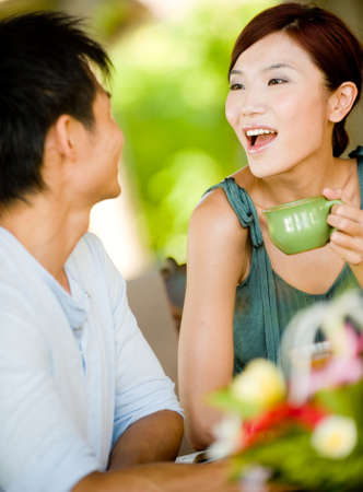 A young couple enjoying breakfast whilst on vacation Stock Photo - 4706695