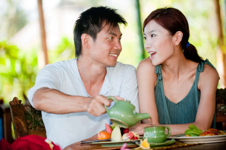 A young couple enjoying breakfast whilst on vacation Stock Photo - 4706694