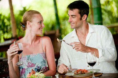 An attractive couple having dinner together at a restaurant photo
