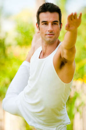 A young man doing yoga in the garden photo
