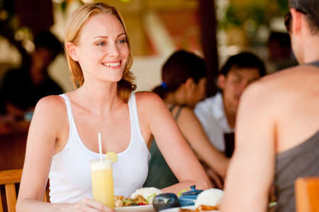 A young couple on vacation enjoying lunch at a restaurant photo