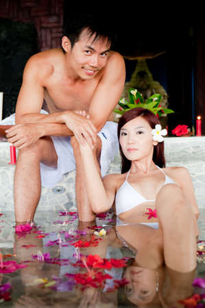 An attractive couple having a spa bath together photo