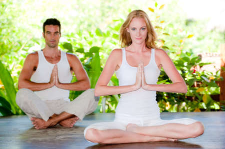 An attractive couple doing yoga together Stock Photo