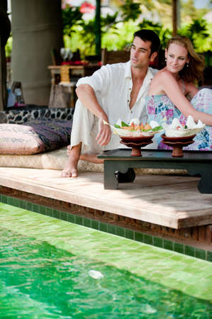 A young couple enjoying a relaxed lunch whilst on vacation Stock Photo