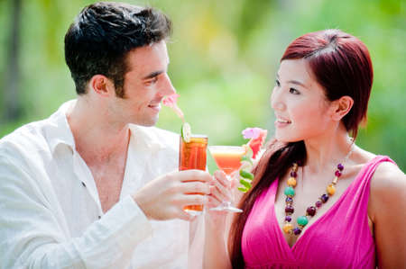 A beautiful woman having cocktails with her man by the pool Stock Photo - 4958038