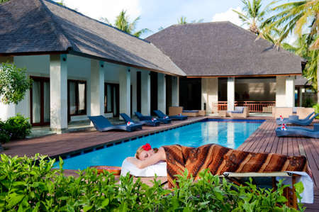 massage table: A woman lying on a massage table at a luxury villa