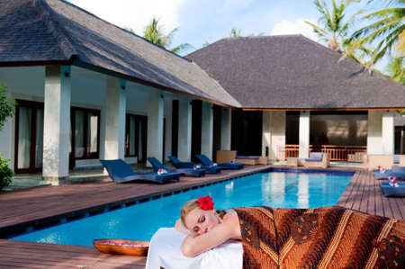 A woman lying on a massage table at a luxury villa Stock Photo - 4958043