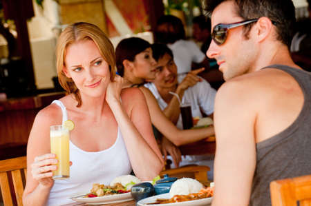 A young couple on vacation enjoying lunch at a restaurant Stock Photo