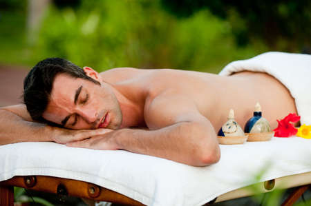 A young man relaxing outside waiting for massage