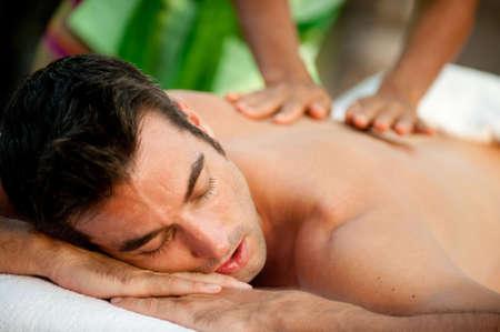 A man getting a massage lying down