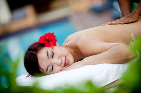 A beautiful young Chinese woman having a massage outside