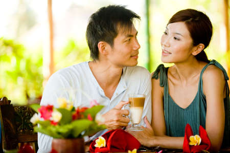 A young couple enjoying breakfast whilst on vacation Stock Photo - 5000060