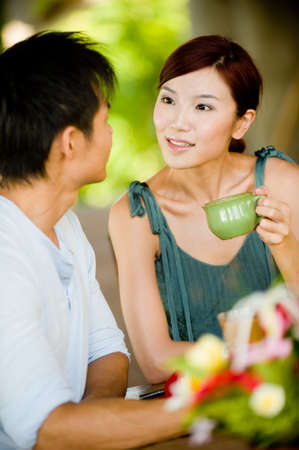 A young couple enjoying breakfast whilst on vacation Stock Photo - 5000070
