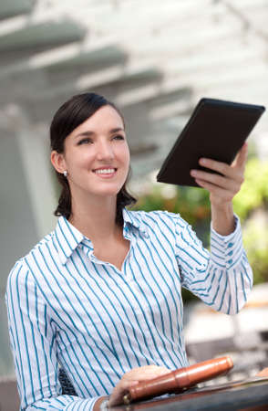 An attractive businesswoman paying the bill Stock Photo - 5035328