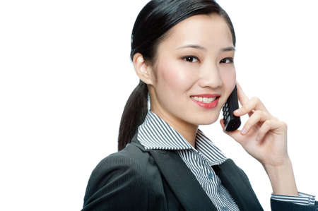 An attractive Asian businesswoman talking on phone against white background photo