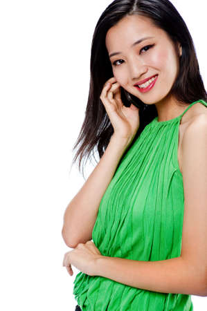halter: An attractive Asian woman in a green halter top with a phone on white background