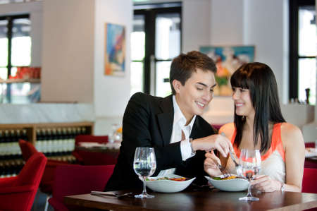 A young and attractive couple dining in a restaurant Stock Photo - 5341033