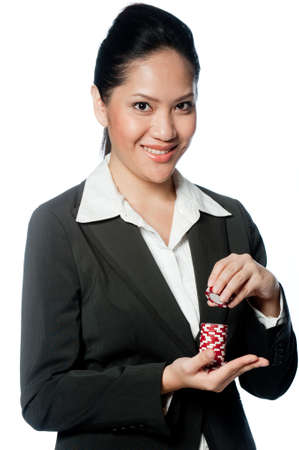 A young businesswoman holding a stack of poker chips photo