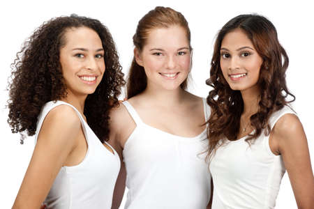 Three young and attractive teenagers with diverse ethnicities against white background Stock Photo - 5427449