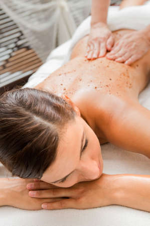 massaged: An attractive caucasian woman getting massaged in a spa Stock Photo