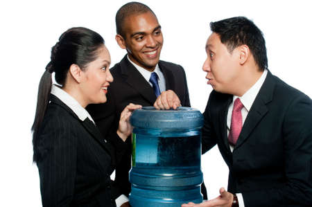 cooler: Three colleagues stand around a water cooler gossiping