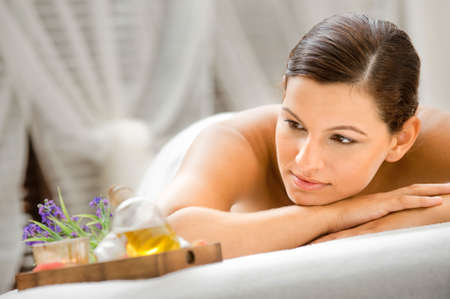 massage oil: An attractive caucasian woman lying down in a spa