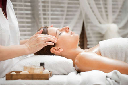 An attractive caucasian woman getting massaged in a spa Stock Photo