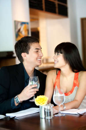 An attractive young couple dining in a restaurant Stock Photo - 5527373