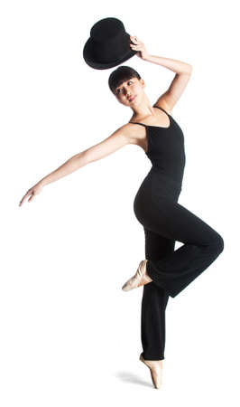 jazz dance: A young attractive ballerina poses with a top hat against white background