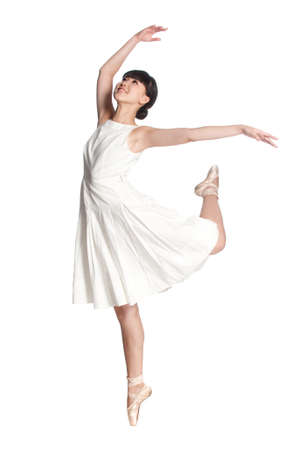 A young asian ballerina dances ballet against white background photo