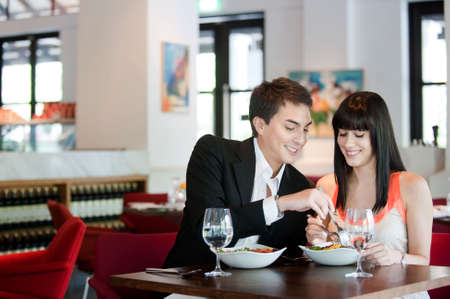 A young and attractive couple dining in a restaurant Stock Photo - 5680743