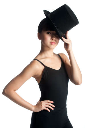 A young asian dancer poses with a top hat against white background photo