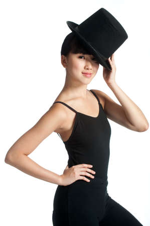 jazz dance: A young asian dancer poses with a top hat against white background