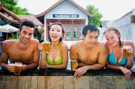 A young attractive Chinese woman drinking a beer in the pool