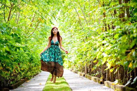 An attractive woman taking a walk through her resort