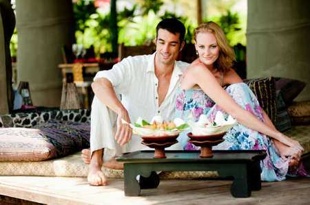 A young couple enjoying a relaxed lunch whilst on vacation photo