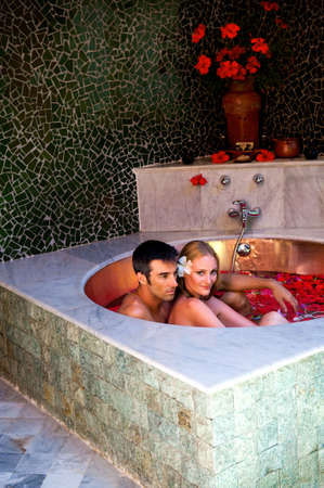 couples therapy: A couple sitting in a bath filled with flowers