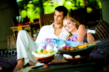 A young couple enjoying a relaxed lunch at a restaurant photo