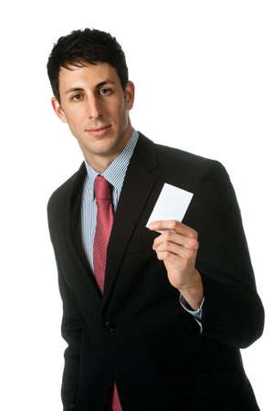 namecard: A good looking businessman holding up his namecard against white background Stock Photo