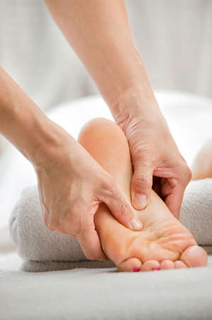 reflexology: A foot massage being carried out in a spa by a masseuse