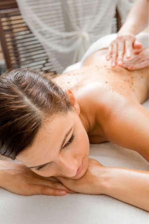 An attractive caucasian woman getting a scrub in a spa photo