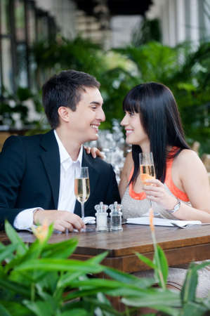 alfresco: An attractive young couple shares a salad at an outdoor restaurant