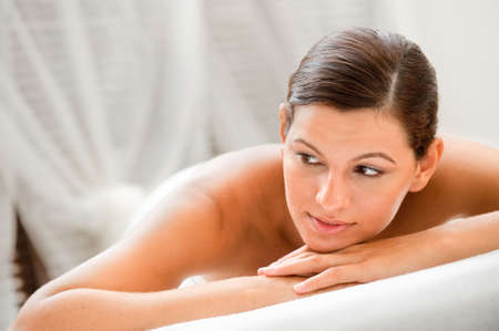 An attractive caucasian woman lying down in a spa