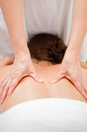 An attractive caucasian woman getting massaged in a spa photo