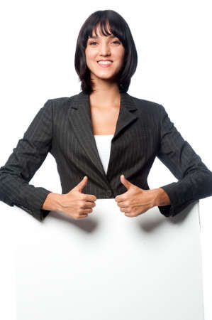 An attractive caucasian businesswoman with a blank card on white background photo