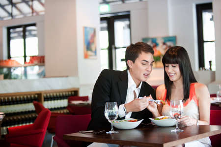 couple dining: A young and attractive couple dining in a restaurant
