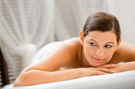 An attractive caucasian woman lying down in a spa photo