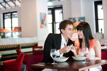 A young and attractive couple dining in a restaurant photo