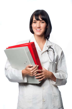 An attractive caucasian doctor holding folders, against white background photo