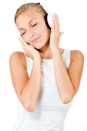 An attractive caucasian woman with headphones on white background Stock Photo